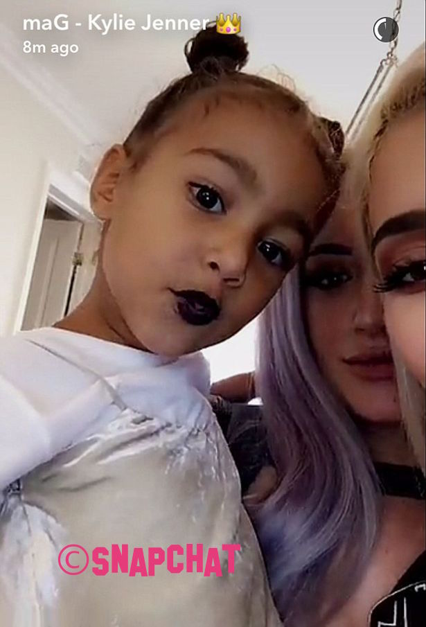 kylie-jenner-receives-backlash-online-after-she-puts-black-lipstick-on-north-west