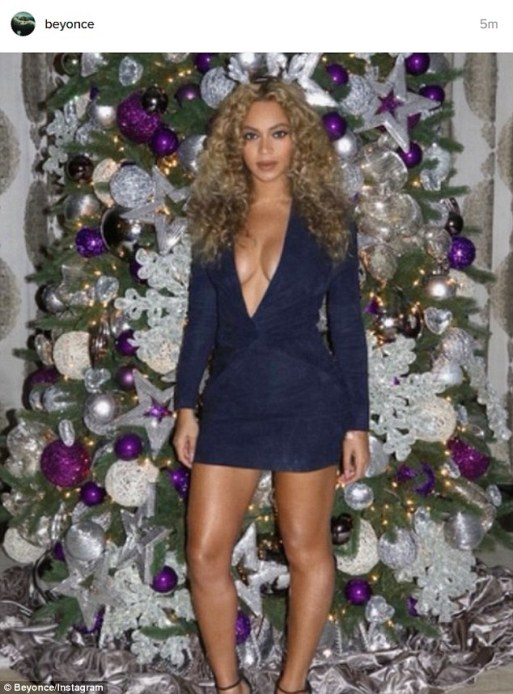 Beyonce Poses In Dark Blue Mini Dress In Front Of Christmas Tree