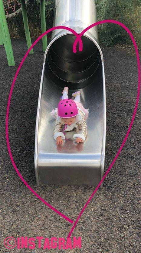 Tamara Ecclestone Makes Daughter Wear Crash Helmet While Playing On Slide
