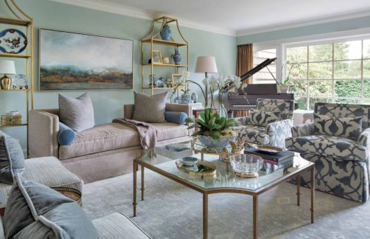 Bolsters in Schumacher mohair and pillows in a GP&J Baker cut velvet dress a recamier-style Kravet sofa in the living room. Additional seating comes from the Thibaut slipper chairs and Lee Jofa swivel armchairs, both wearing Barbara Barry for Kravet fabrics.