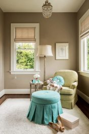 A small arm chair and ottoman are parked conve-niently by the closet in the dressing area of the master bedroom.
