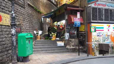 small flower shop in the middle of the party district
