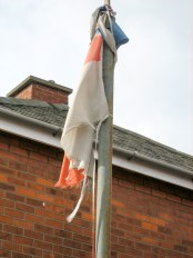 Remains of tattered Northern Ireland flag on lamppost. (c) Gordon GILLESPIE