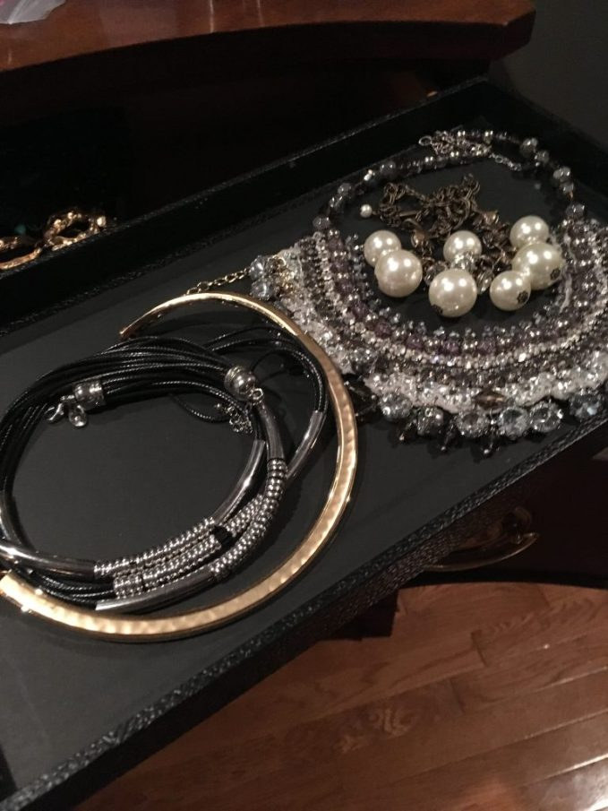 using stackable jewelry trays to store and display necklaces that need to lay flat