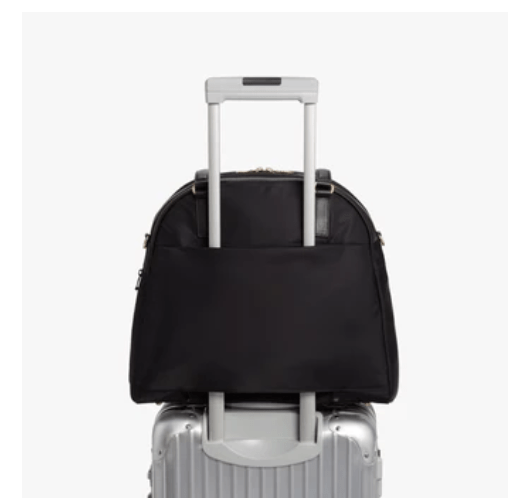 Lo & Son's OG/OG 2 Bag fits on your suitcase handle for easy travel