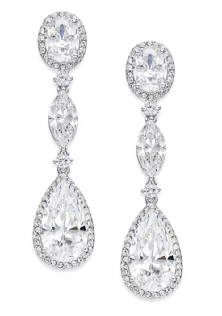 Drop crystal earrings add glamour and are good choice for round faces