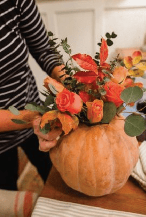 For a buffet table, use a carved out pumpkin as a vase for fresh or faux flowers.  I have used ones from Michaels and fill it with interesting greenery, flowers, berries, and cattails.