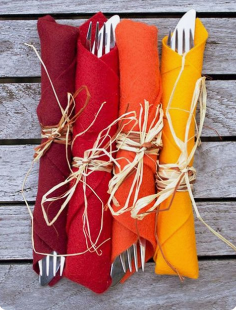 Simple raffia tied around colorful napkins are perfect for dinners served buffet style where sitting is not designated