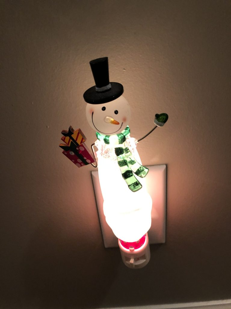 One of my favorite Secret Santa gifts is this nightlight.  This whimsical decor helps light the halls for my early mornings during the holidays