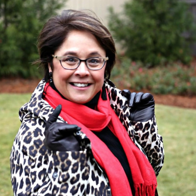 """A much """"warmer"""" red works as a POP of color with this coat on a rainy day."""