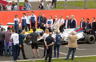 Sir Frank Williams and past and present members of the Williams
