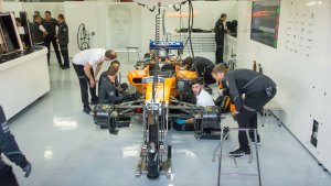 Work continues feverishly in the McLaren garage after testing on Wednesday