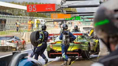 Busy pit lane with Aston Martin Vantage pit stop. WEC 4 Hours of Silverstone 2019