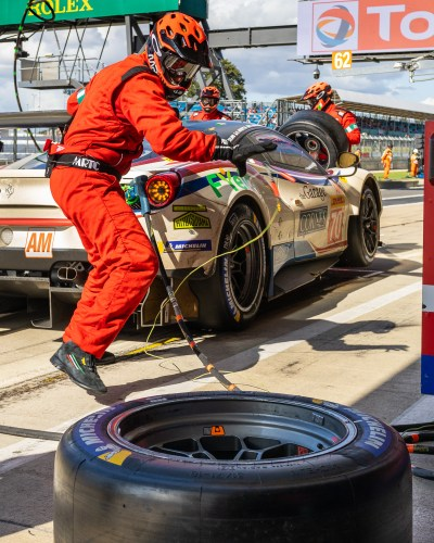 Pit crew member turns to retrieve a wheel. WEC 4 Hours of Silverstone 2019