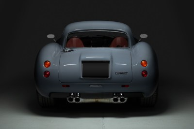 Rear view in light and shadow of a grey 2019 Dowsetts Classic Cars Comet