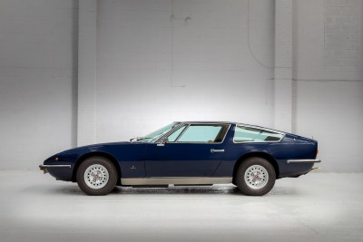 Side view of a blue 1971 Maserati Indy America 4700