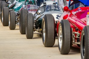 View of wheels from pre 1966 grand Prix cars as they line up in the paddock prior to racing on track. Silverstone Classic July 2018