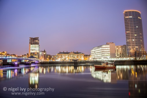 It's been grey and dark here in Belfast since getting back from the USA, so there's been virtually no sunrise or sunset. It also gets dark at 4pm. Here's a shot I took of the Cathedral Quarter across the river tonight.