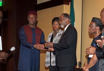 ANPA President Dr. Nkem Chukwumerije giving Dr. Ohiaeri of First Consultants an award at the ANPA Gala
