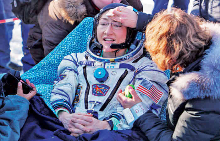 US astronaut longest mission woman Christina Koch, returns to Earth