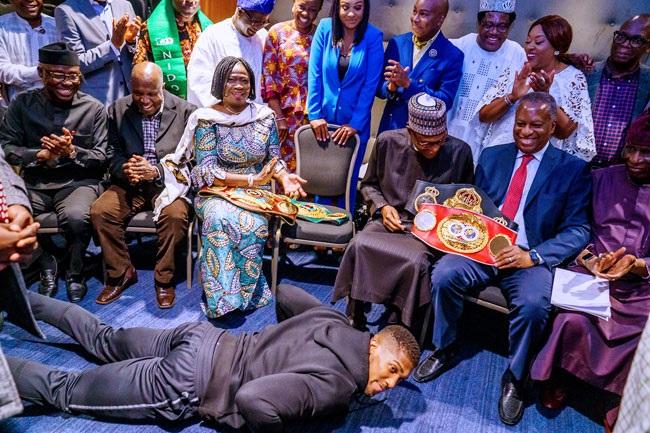 Anthony Joshua prostrates to buhari