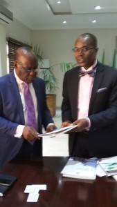 Dr Anthony Anuforom, DG Nimet  exchanging documents with Engr Bola Bido, President Nigerian Society of Engineers, Aeronautical Division during a courtesy visit to NIMET DG in Abuja.