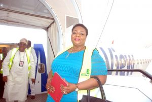 Mrs Senanu Ladipo, Relationship Manager Corporate Banking Group Infrastructure, First Bank PLC  striking a pose before boarding
