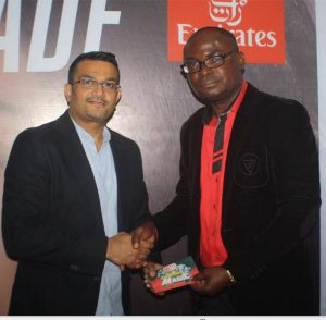 The Emirates Regional Manager West Africa Mr Manoj Nair, presenting a free movie ticket to one the winners of the Competition, Mr Patrick Omenye, at the Emirates Cinema Grand Finale Event