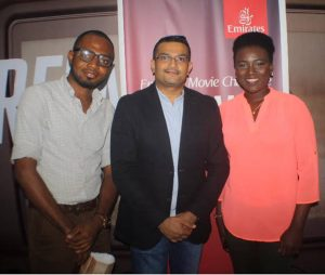 Winners of the Competition, Adejoh Marvelous, and Tioluwanimi Odukoya, with the Emirates Regional Manager West Africa, Mr Manoj Nair, at the Emirates Cinema Grand Finale Event