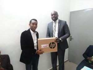 Mr. Akin Arogundade and the first place winner