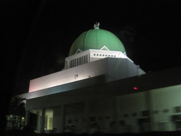 The controversial dome of the National assembly as seen at night