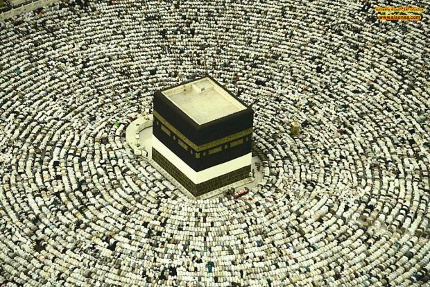 The Kaaba, the cloth-covered cubic structure that's Islam's most sacred shrine. Thousands of Muslims circle the Kaaba at prayer during the haj in Mecca December 24, 2006. REUTERS/Ali Jarekji REUTERS/Ali Jarekji (SAUDI ARABIA)