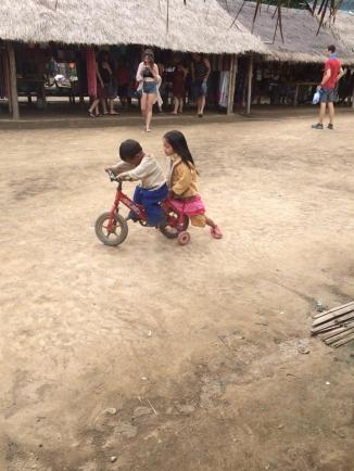 Karen children playing near the vendors