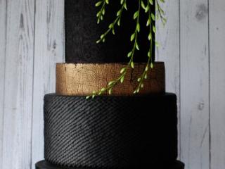 Black wedding cake with purple flower