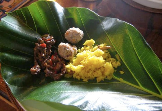 Turmeric flavoured rice on a breadfruit leaf
