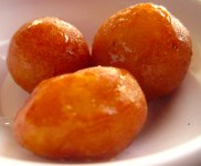 Fried pastries in honey and rosewater syrup