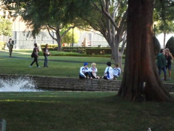 Sneaky picture of some Free! cosplayers hanging out by the pond.