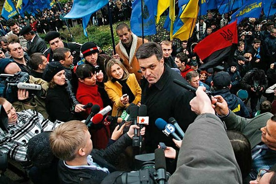 "Svoboda's Oleh Tyahnybok at a ceremony in 2009, celebrating Stephan Bandera, Nazi ally during the WWII, whose organization massacred Jews and Poles, now rehabilitated in Ukraine as ""a patriot"" and ""national hero""."