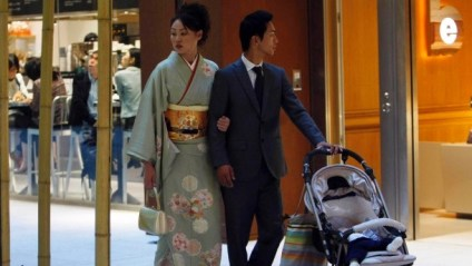 a-couple-walks-around-a-shopping-mall-in-tokyo