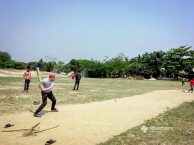 Playing cricket with the local kids
