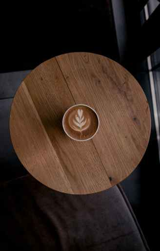latte art in cup of coffee on a round table
