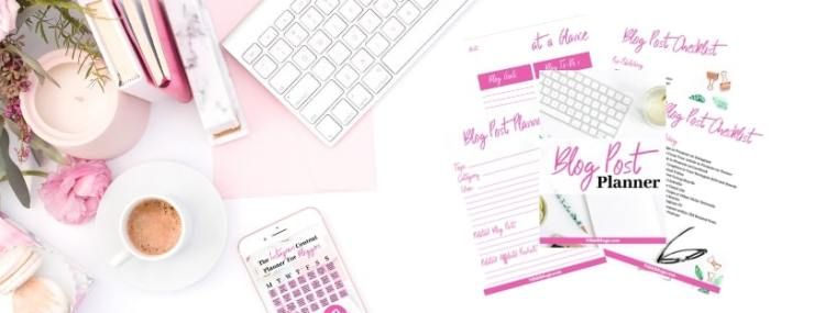 image shows items like stationary and a keyboard near the top left corner as well as a coffee cup with the blog post planner bundle to the right side layered as sheets