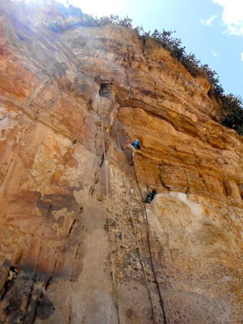 Igal climbing the rope to Debre Damo