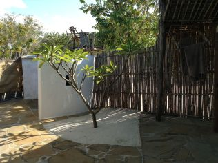 Outside bathroom....with pulley jerrycan shower