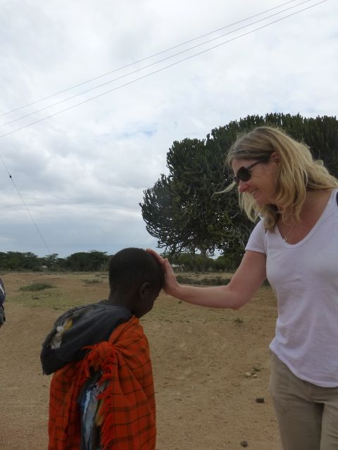 Traditional greeting to a Masaai child..