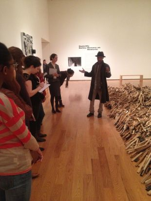 """Radcliffe Bailey talking to my class before the exhibition opening of """"Radcliffe Bailey: Memory As Medicine"""" at the Davis Museum. Photo by Nikki A. Greene."""