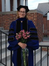 Tanya dons the UD ceremonial doctoral robes. Another Mama PhD crowned!
