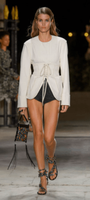 ISABEL MARANT The bell bottom sleeved top paired with short-shorts is simple yet chic as the ivory on top compliments the black bottoms.
