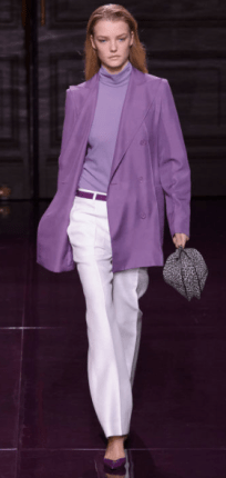 NINA RICCI The designs all featured relaxed tailoring, as seen in the extra long, loose double-breasted blazers, straight-leg pants and slim midi skirts. The looks represented the business wear uniform of the 1980s - however the mix of lavender and leopard print does not belong in a working girl's wardrobe.
