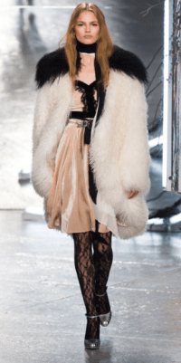 RODARTE The 70s glam-rock motif was strong as Mongolian furs were thrown over Lurex dresses and slinky suits.